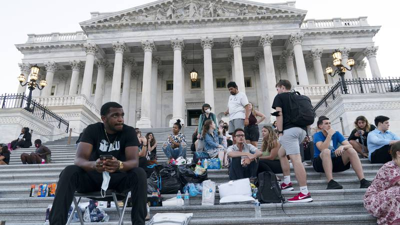 Supporters of Rep. Cori Bush, D-Mo., camp with her outside the U.S. Capitol, in Washington,...