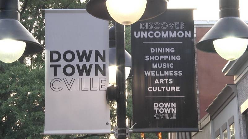 Signs on the downtown mall, where many Charlottesville businesses reside.