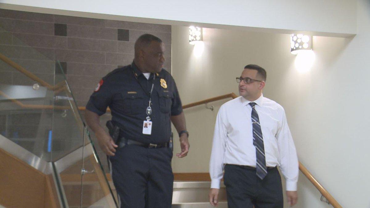 Harrisonburg police chief Eric English and deputy police chief Gabriel Camacho on Camacho's...