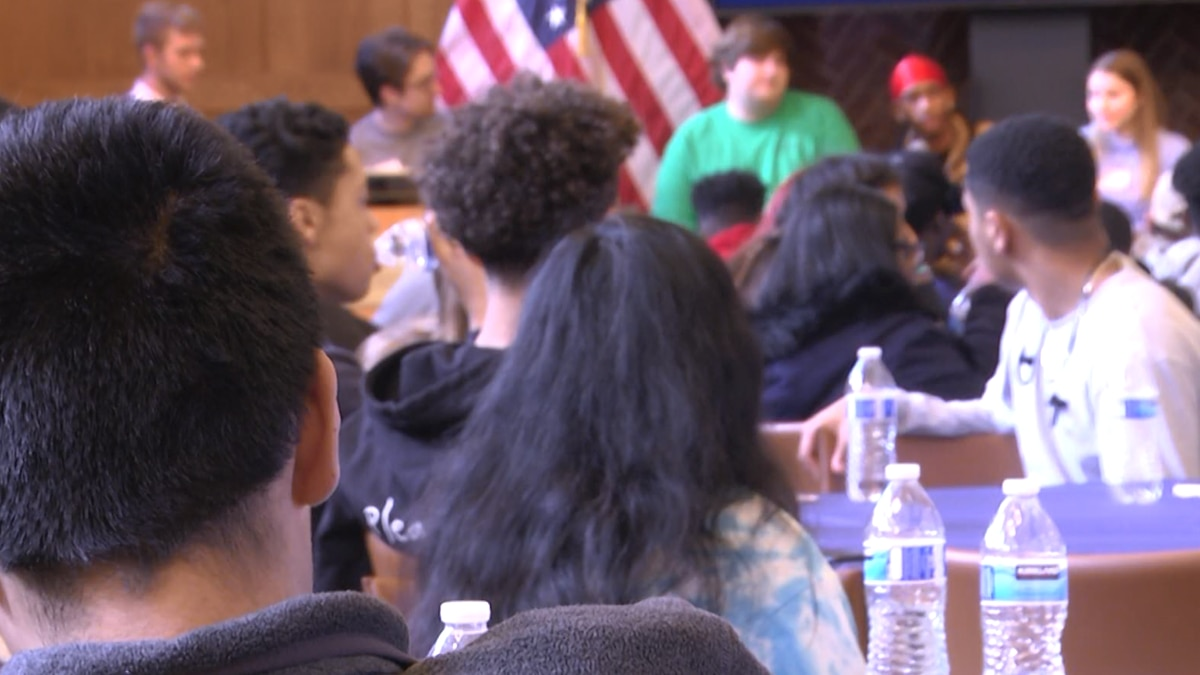 Charlottesville High School students watch a presentation from Batten School students.