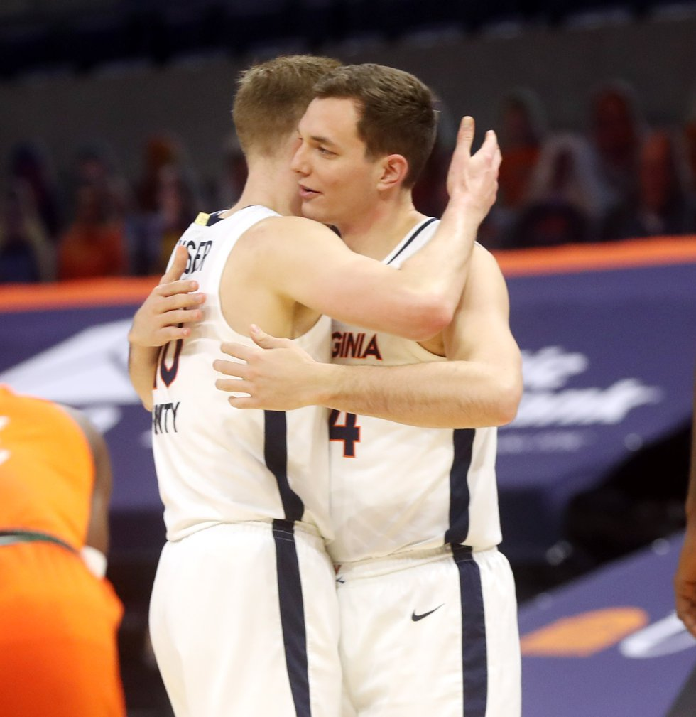 ANDREW SHURTLEFF, THE DAILY PROGRESS Virginia forward Sam Hauser (10) receives a hug from...