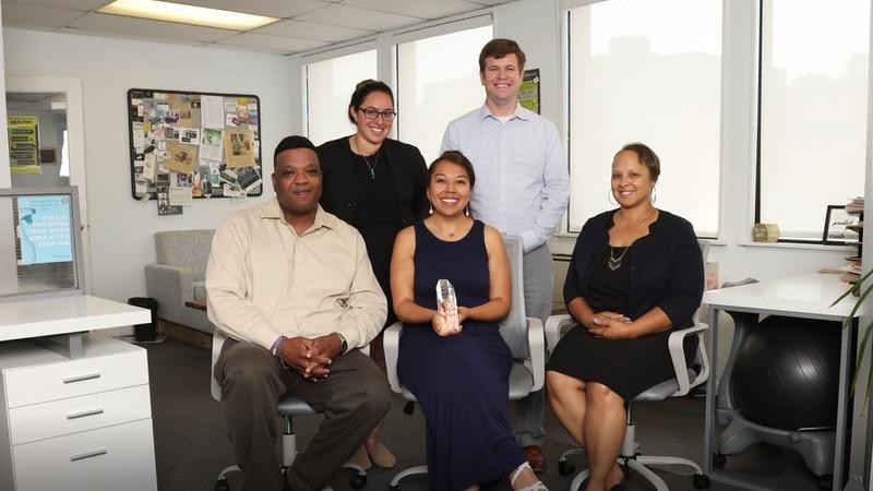 CIC Staff smile with Vanguard Award.