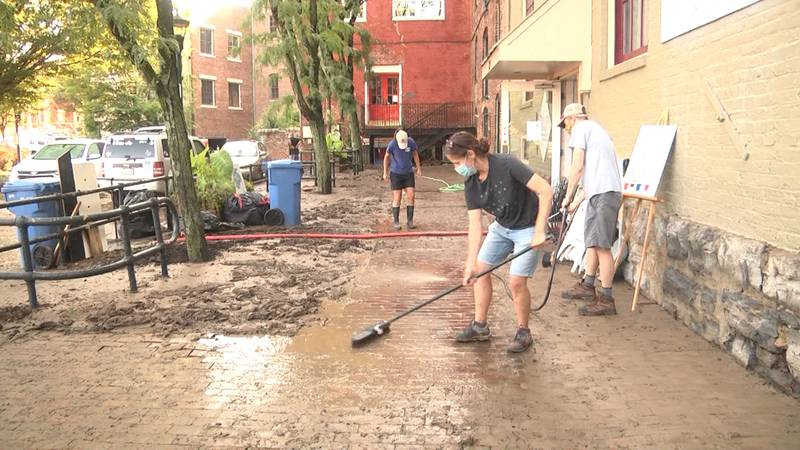 People in Staunton's Wharf District cleaning up the day after the August 8, 2020 flood.