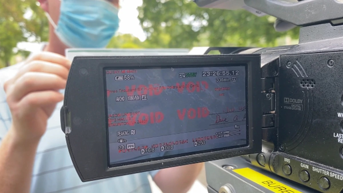 """Our camera picked up the word """"void"""" that was stamped all over the check, but hidden to the..."""