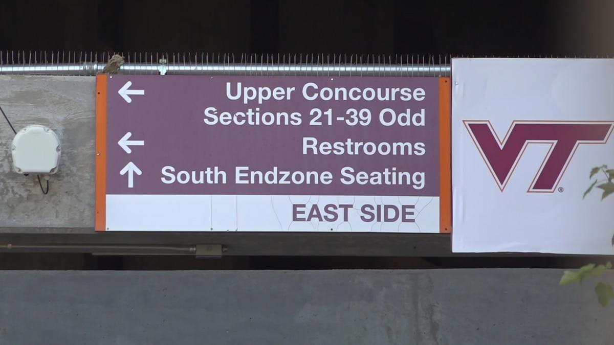Signs leading to stadium seating at Lane Stadium.