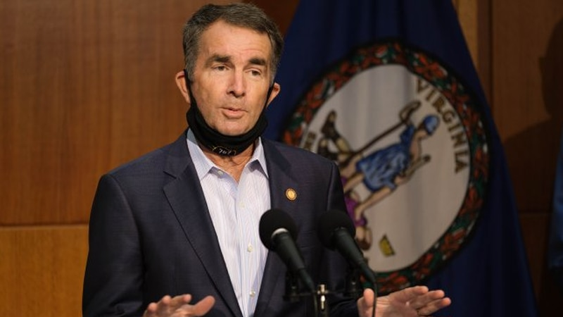 Gov. Ralph Northam speaks at a news conference in August.
