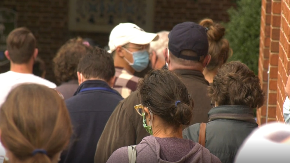 Early voters wait in line outside the Charlottesville Office of Elections to cast their ballots.