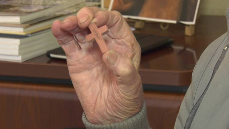 Tiny crosses carved by a 92-year-old man is brightening the days of some people in the armed...