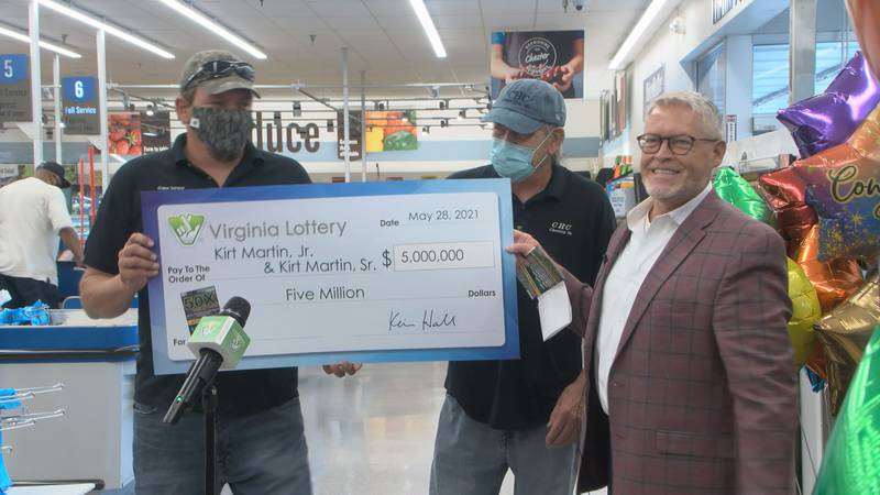 Father and Son awarded check for $5 Million after winning top prize in scratch-off.