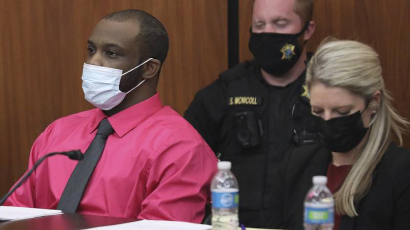 Defendant Nathaniel Rowland sits with his attorney Alicia Goode during closing arguments in his...