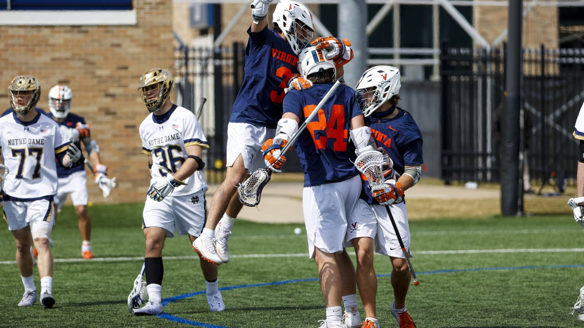 Ian Laviano (3) and Payton Cormier (24) celebrate during UVA's 12-11 win at Notre Dame