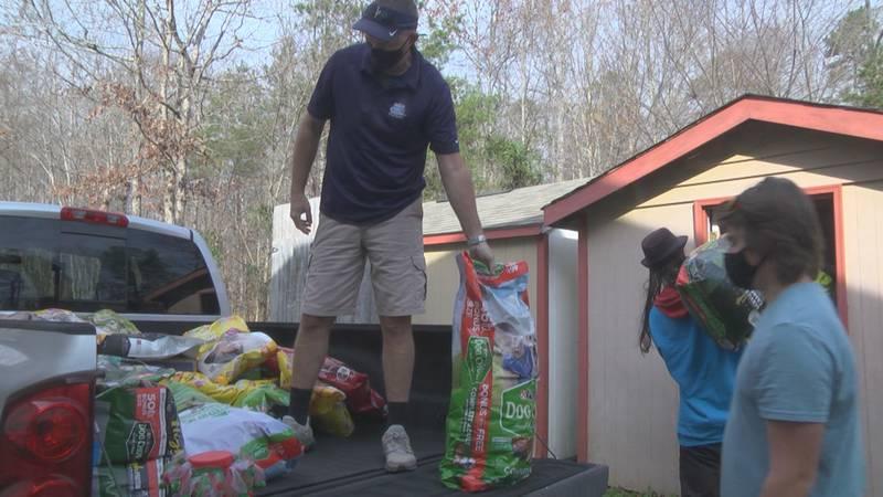 Volunteers distribute pet food at the Fluvanna SPCA.
