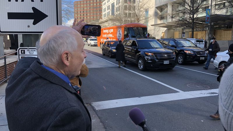 Philip Van Cleave with Virginia Citizens Defense League records video on his phone during the...