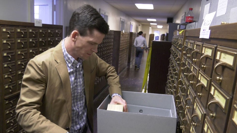 Neil Curtis and Sam Lemley working to save the card catalog at UVA's Alderman Library.