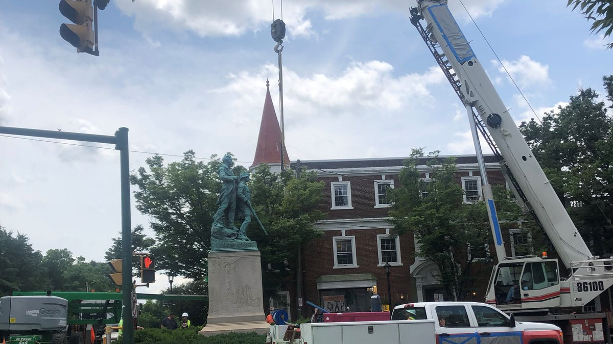 Lewis & Clark and Sacajawea statue on West Main St. being removed. (FILE)