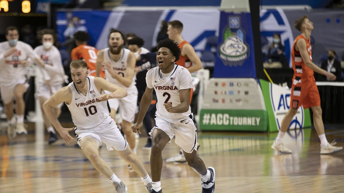 Virginia's Reece Beekman (2) celebrates after sinking the game winning shot at the buzzer to...