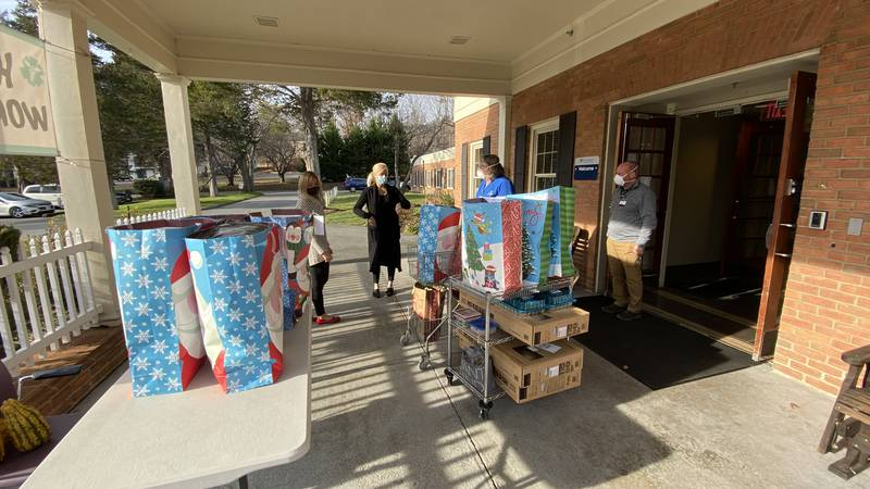 Staff at Focused Ultrasound deliver gifts to Cedars Healthcare Center