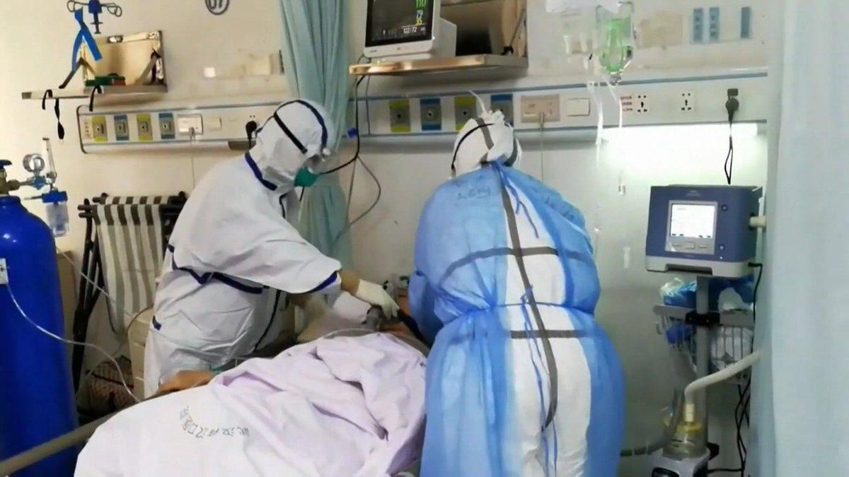Doctors treat a patient in a COVID unit. (WHSV File)