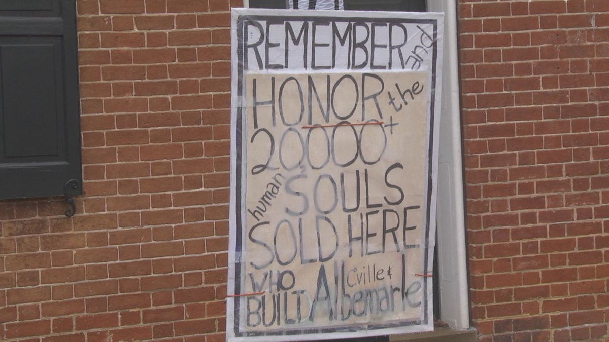 Sign remembering the enslaved people who were sold in Historic Court Square.