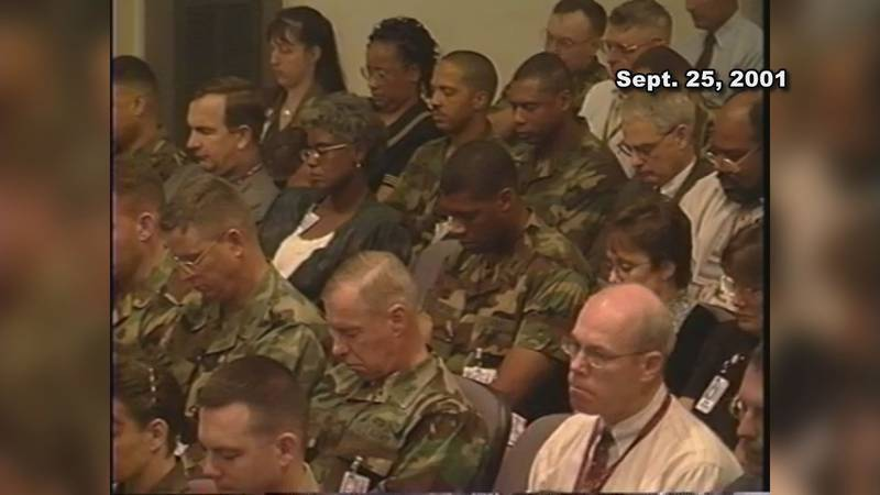 Members of the U.S. Military watch and listen to Joel Jenkins serve as Chaplain, two weeks...