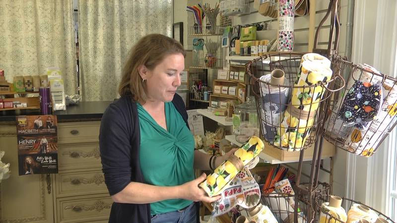 Refill Renew owner Mandy Drumheller showing the un-paper towel works.