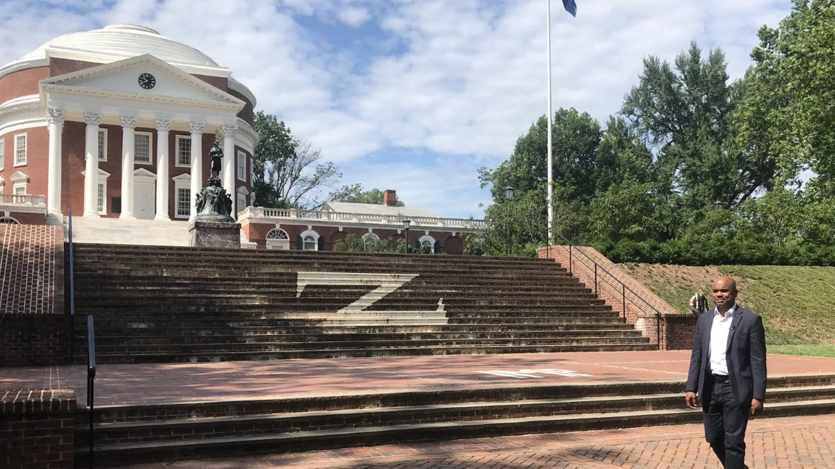Assistant professor Paul Harris walks in front of the Rotunda at the University of Virginia.