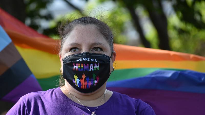 A woman in support of the transgender policy in Albemarle County Public Schools attends a rally...