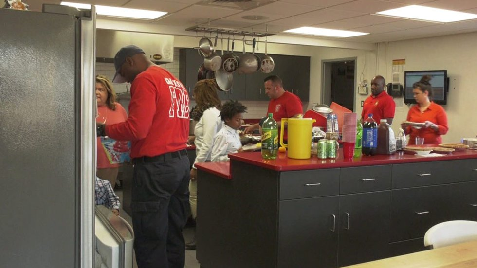 Fire fighters preparing a Thanksgiving meal at the Ridge St. Station in Charlottesville