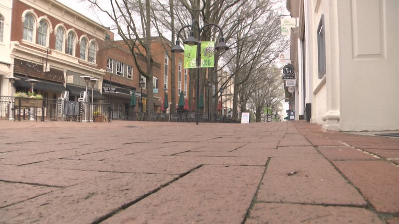 The Downtown Mall, which would be bustling as the weather gets warmer, is all but abandoned as...