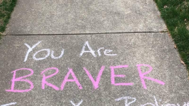 A message of positivity on an Albemarle County sidewalk.