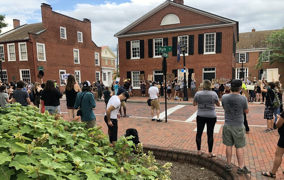 People taking part in a Walk for Justice gather in Charlottesville's Court Square