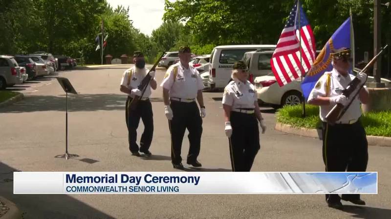 American Legion Post 74  color guard is presenting the colors at a Memorial Day event.