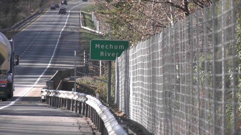 Deer fencing along I-64 in Albemarle County redirecting wildlife from the interstate.