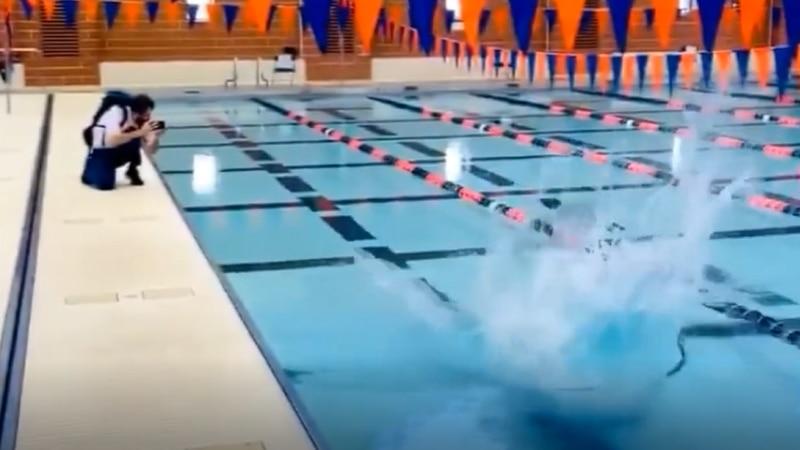 UVA's President Jim Ryan celebrates women's swim and diving team's win with a splash.