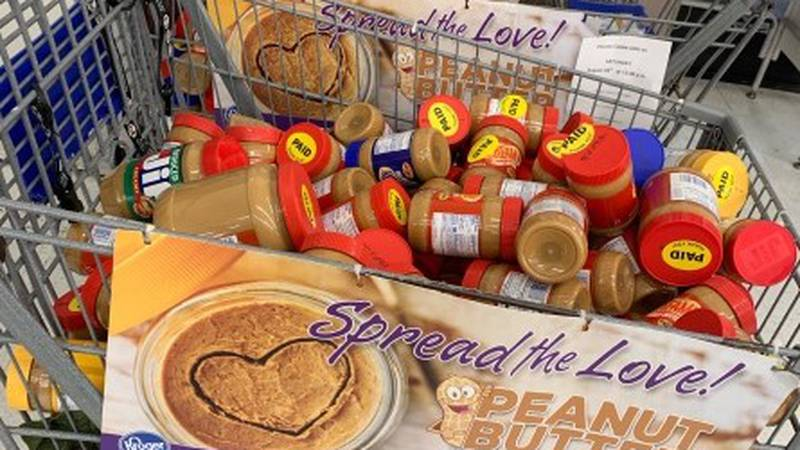 """Peanut butter collected for the """"Spread the Love"""" event."""