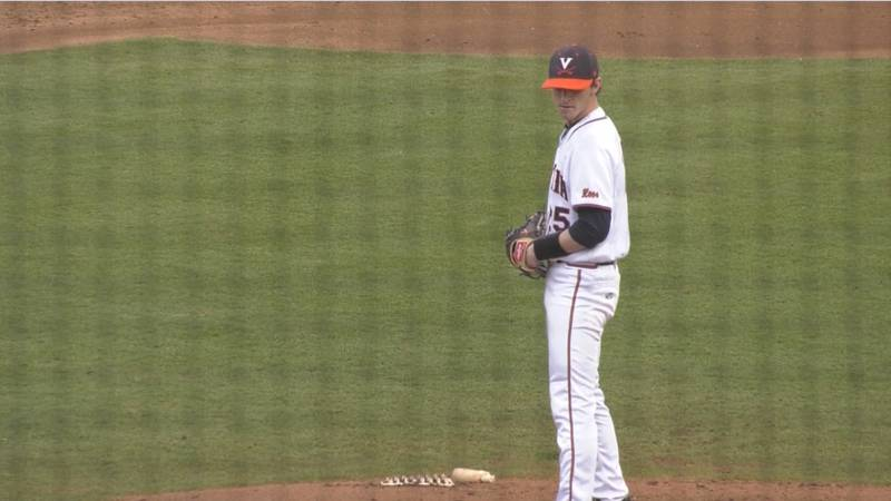 A University of Virginia baseball pitcher stands on the mound.