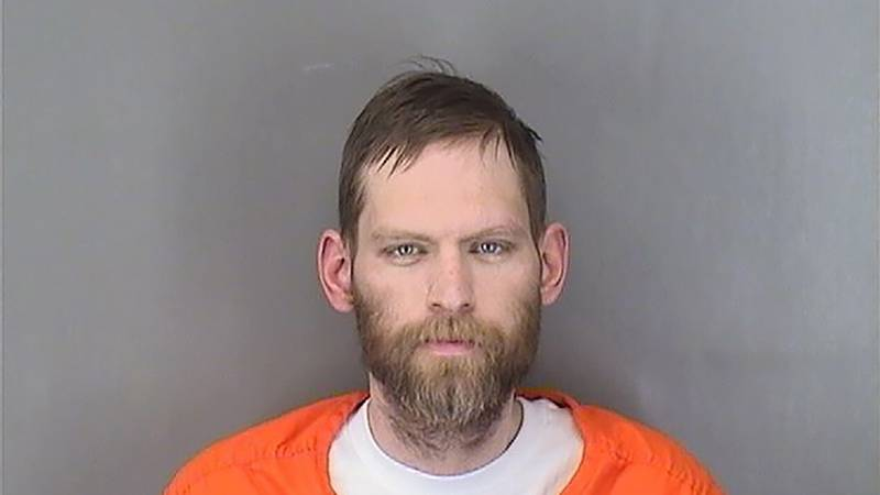 This booking photo provided by the Sarpy County Sheriff's Department shows Adam Price after his...