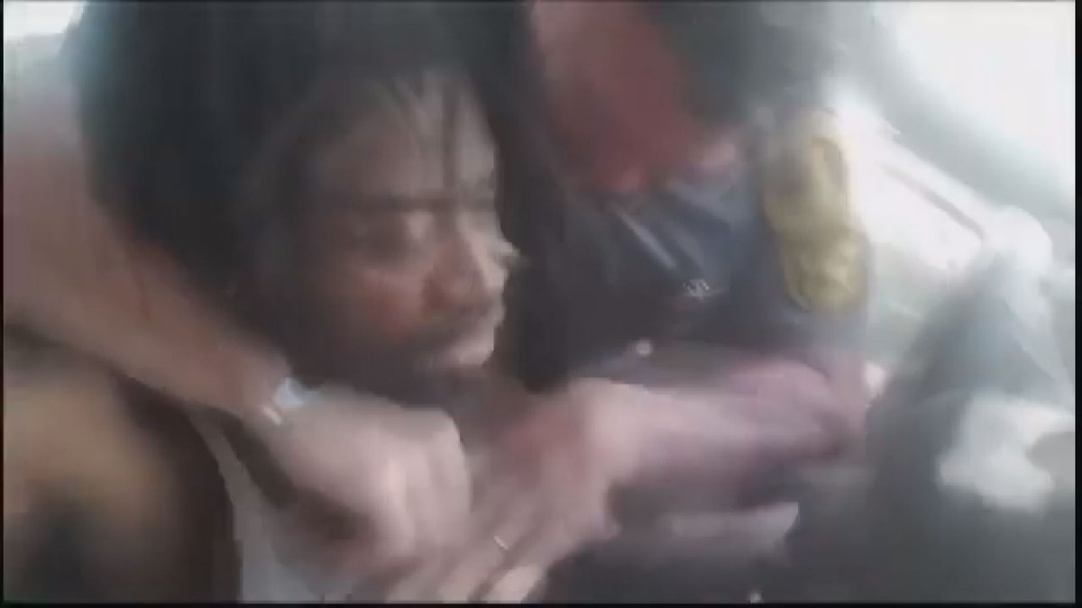 VSP Trooper captured forcibly grabbing man out of car, says to camera 'Watch the show'.