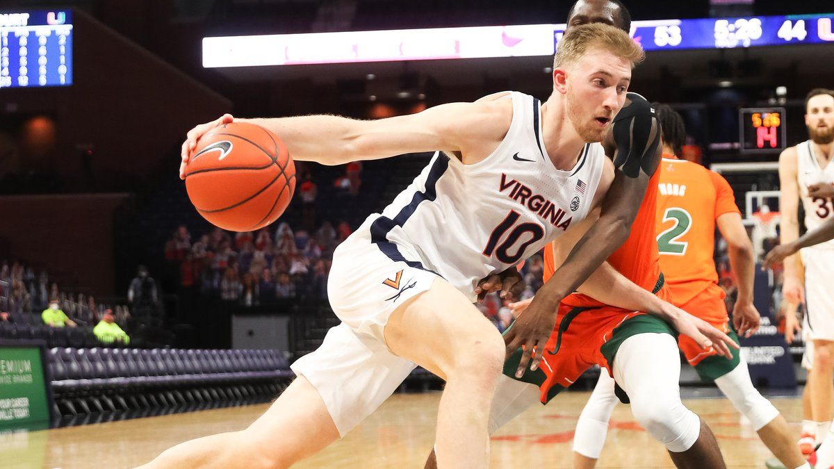 ANDREW SHURTLEFF, THE DAILY PROGRESS Virginia forward Sam Hauser (10) does past Miami guard...