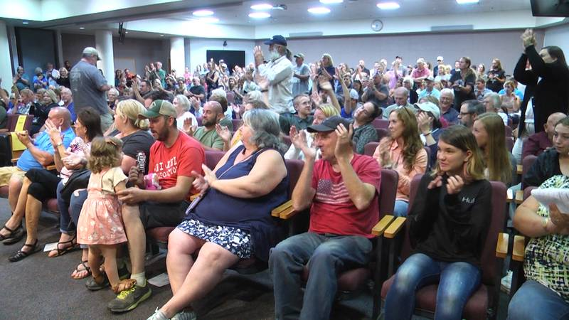 People in Augusta County cheering for a person who spoke out against transgender policy during...