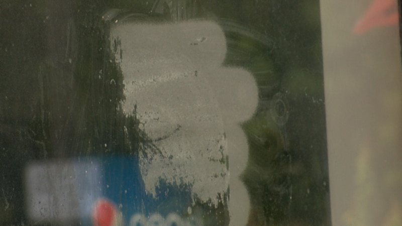 Residue remains on windows where Hanover Sheriff's deputies say flyers with swastikas were...