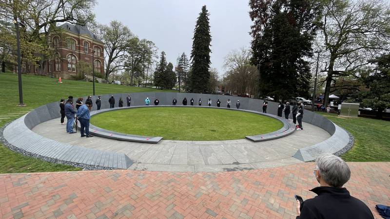A small group gathers for the completion of the Memorial to Enslaved Laborers at UVA.