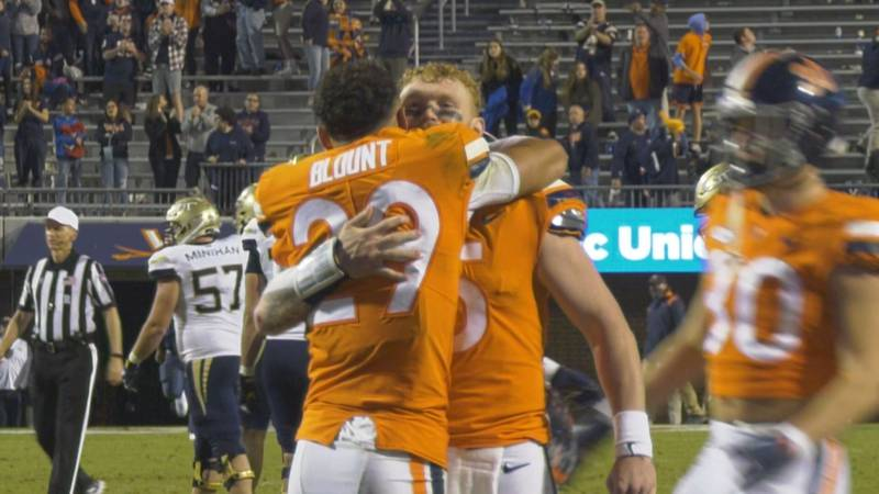 Joey Blount hugs Brennan Armstrong, after batting away a potential game-tying touchdown pass.