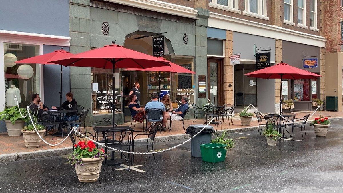 People enjoying outdoor dining at Yelping Dog Wine in downtown Staunton