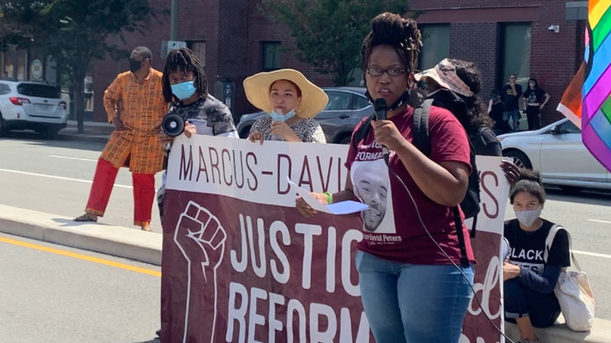 Princess Blanding, sister of Marcus-David Peters, speaks to protesters outside the Stuart C....