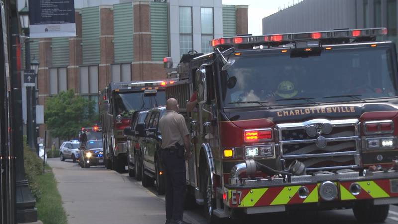 Fire officials waiting to escort a family leaving UVA Medical Center.