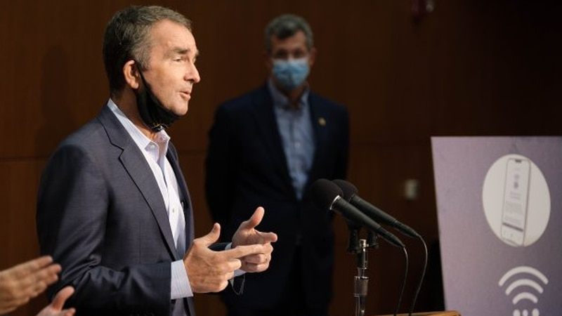 Gov. Ralph Northam urged residents to download the state's new COVID-19 exposure notification...