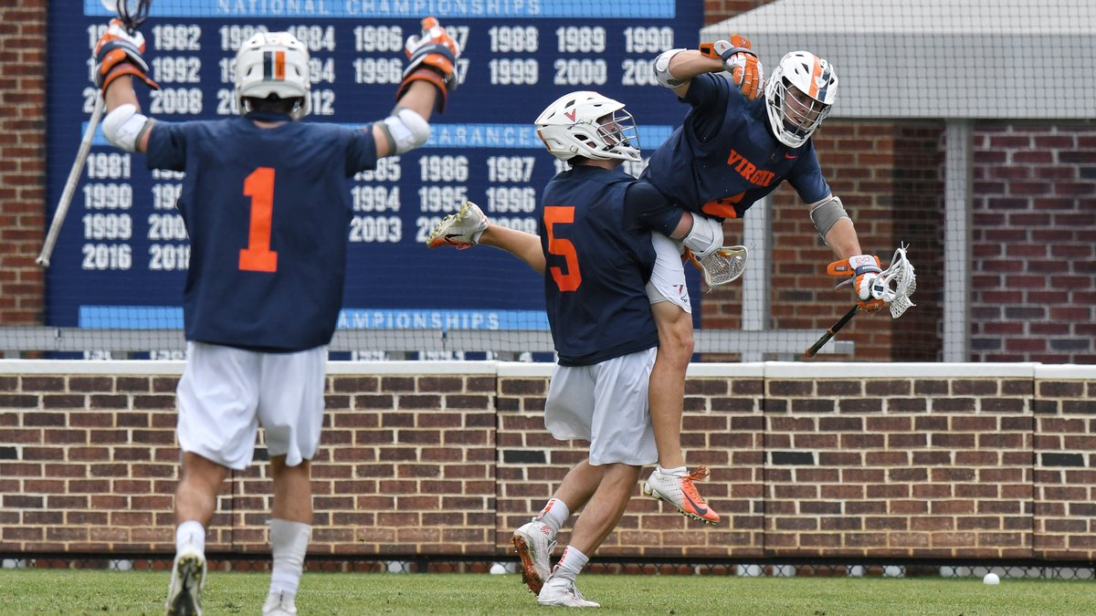 The Cavaliers celebrate an 18-16 victory at North Carolina