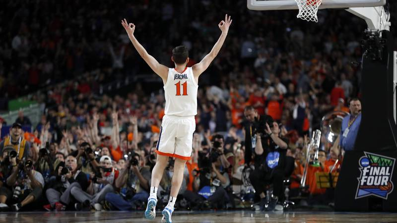 Virginia's Ty Jerome (11) reacts after shooting a 3-point basket during the first half in the...