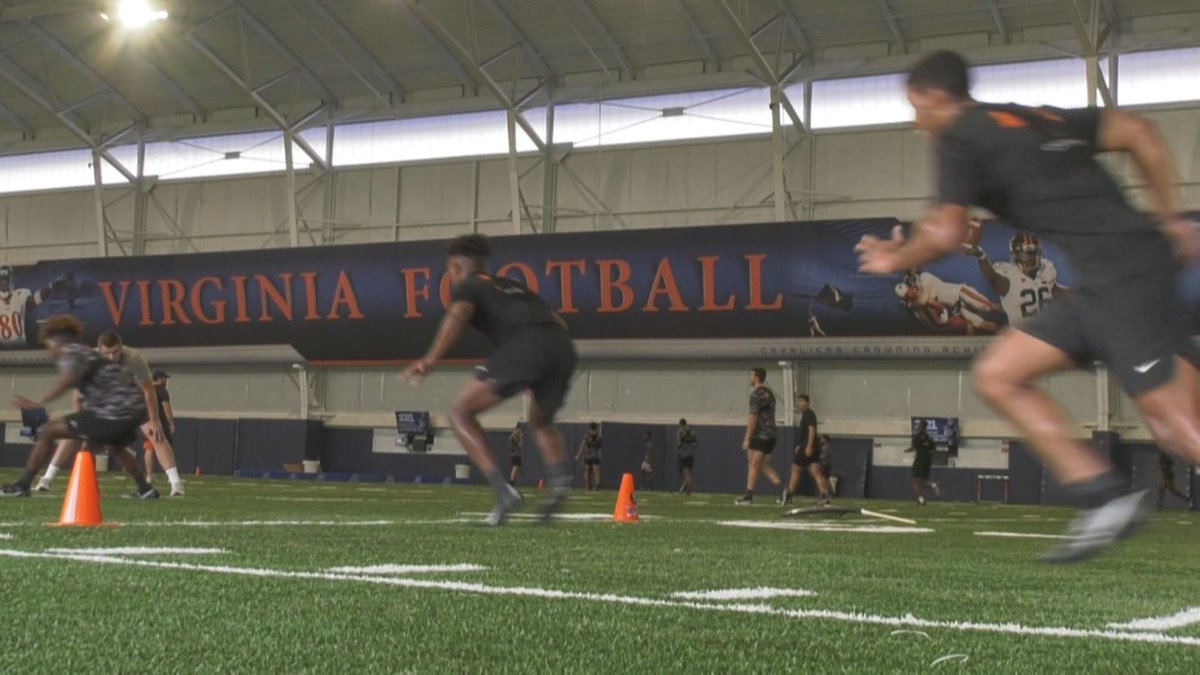 The UVA football team runs through drills on the final day of summer workouts.